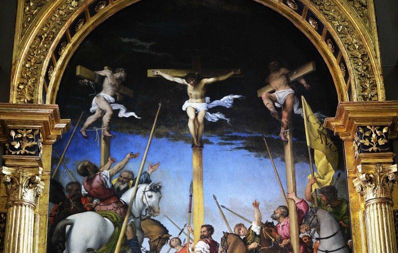 L. Lotto, Crocifissione, particolare del cielo plumbeo sovrasta il Golgota